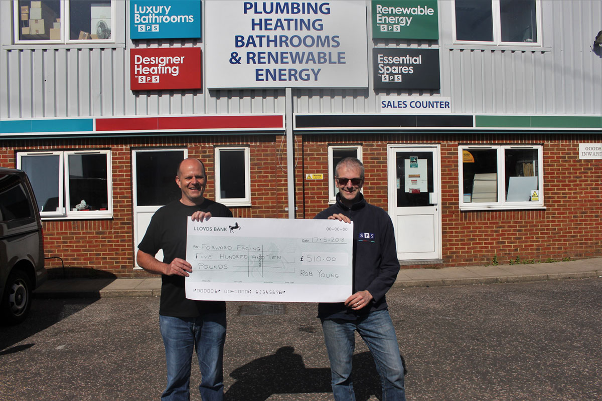 SPS Manager Rob Young hands over a cheque for £510 to Forward Facing Charity