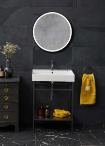 Matt black taps, towels rails and WC holders from the Hoxton range from Britton and Britton's Shoreditch Frame Furniture Stand and Basin